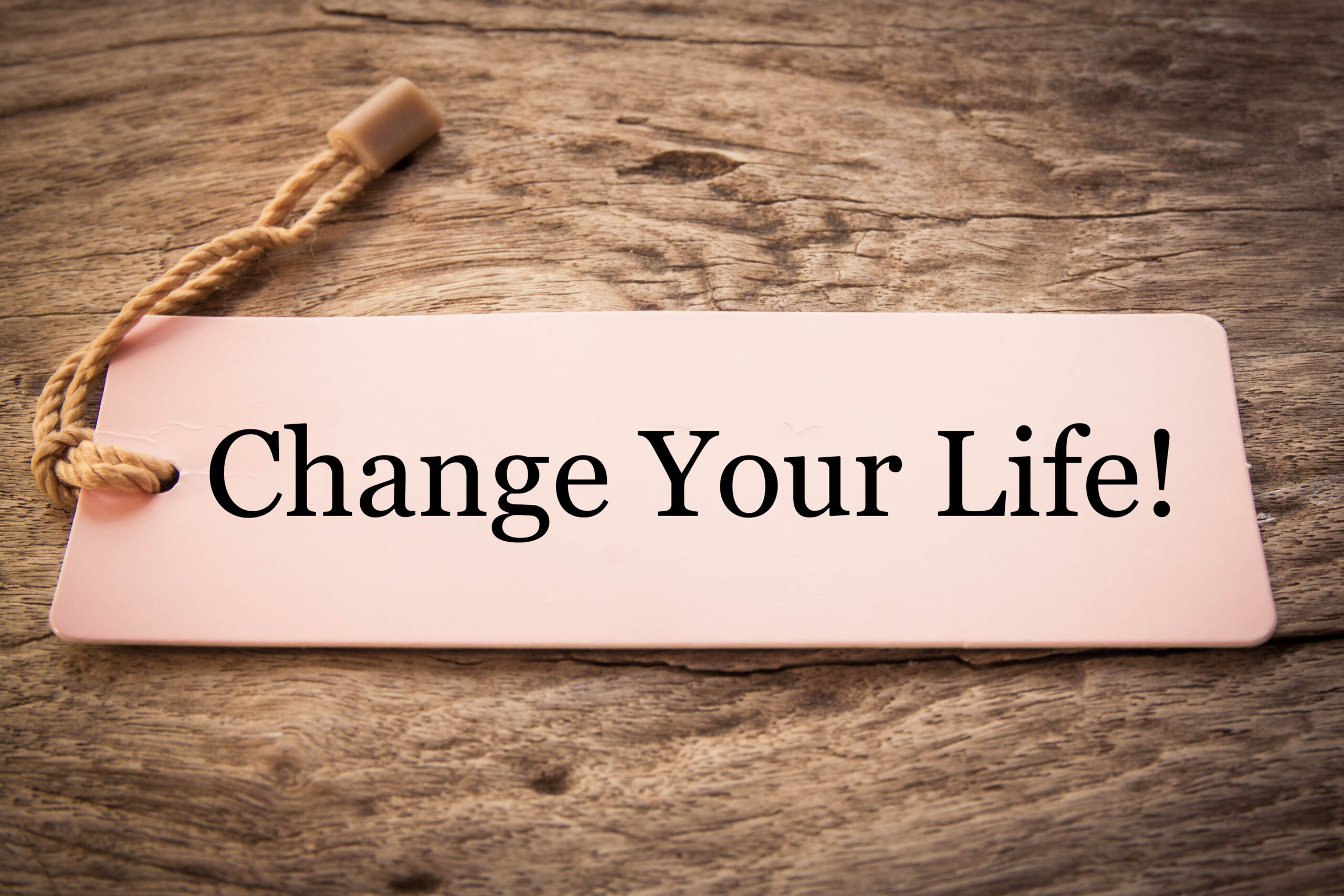 """sign that says """"change your life"""""""